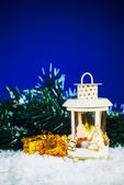 Christmas lantern with the presents — Stock Photo