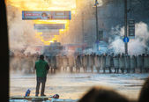A row of the riot police with a priest at Hrushevskogo street in — Stock Photo