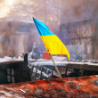 Ukrainiflag on barricade at Hrushevskogo street in Kiev, — Stock Photo #39525869