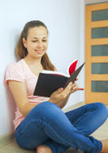 Young attractive lady with a book — Stok fotoğraf