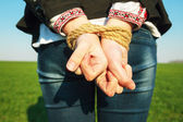 Hands tied up with rope — Stock Photo