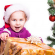 Portrait of a beautiful girl in Santa — Stock Photo