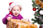 Portrait of a beautiful girl in Santa — Stock Photo