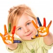 Portrait of a happy cheerful girl showing her hands painted in bright colors — Stock Photo