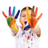 Little boy with hands painted in colorful paints ready for hand — Stock Photo