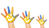 Family concept. Three colorful hands with smiling face of family - mother, father and baby. Small, medium and large hand. Symbol unity, growth, ready for your logo. Isolated on white background — Stock Photo