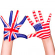 American and English flags on hands. — Stock Photo #20085357