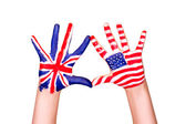 American and English flags on hands. — Stock Photo