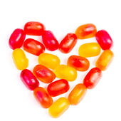 Colorful jelly candy love note in shape of heart — Stock Photo