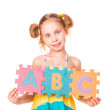 Happy girl holding alphabet letters ABC — Stock Photo #20504455