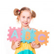 Happy girl holding alphabet letters ABC — Stock Photo