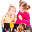 Two happy kids painting easter eggs. Happy Easter — Stock Photo