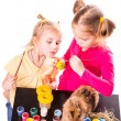 Two happy kids painting easter eggs. Happy Easter — Stock Photo #21126005