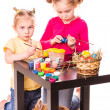 Two happy kids painting easter eggs. Happy Easter — Stock Photo #21126023
