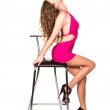 Beautiful sexy woman dancing with bar chair — Stock Photo #21908433