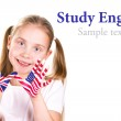 American and English flags on child's hands. — Stock Photo
