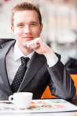 Young handsome businessman drinking coffee — Stock Photo