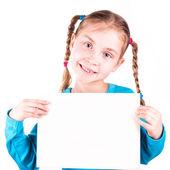 Smiling little girl holding white card for you sample text — Stock Photo