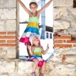 Beautiful little girls in ancient ruins of the Nesebar — Stock Photo