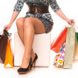 Stock Photo: Womlegs in highheels with many shopping bags. Shopping concept.