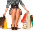 Woman legs in highheels with many shopping bags. Shopping concept. — Stock Photo