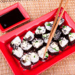 Stock Photo: Vegetarisushi roll served on red plate