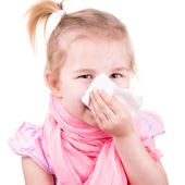 Sick little girl with chickenpox with napkin — Stock Photo
