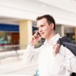 Handsome young and successful businessman talking on his mobile phone — Stock Photo #24878869