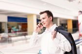 Handsome young and successful businessman talking on his mobile phone — Stock Photo