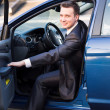 Handsome young businessman in his new car — Stock Photo #24881025