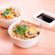 Rice with vegetables and mushrooms with soy sauce — Stock Photo
