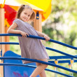 Beautiful little girl on outdoor playground - Photo
