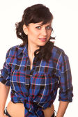 Beautiful sexy girl in casual shirt and jeans isolated — Stock Photo