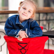 Cute little child sitting in a cafe in shopping mall — Lizenzfreies Foto
