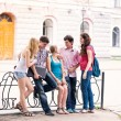 Group of happy smiling Teenage Students Outside College — Stock Photo