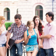 Group of happy smiling Teenage Students Outside College — Stock Photo #25592913