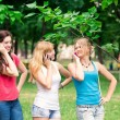 Stock Photo: Group Of happy smiling Teenage Students outdoor
