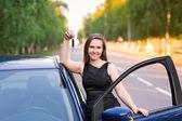 Beautiful businesswoman near her car — Stock Photo