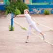 Adorable little child playing tennis — Stock Photo #26007725