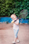 Adorable little child playing tennis — Stock Photo