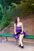 Beautiful young girl in a beautiful dress outdoor — Stock Photo