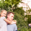Happy father and daughter playing in the park — Foto de Stock