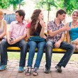 Group of happy smiling Teenage Students Outside — Stock Photo #27004291