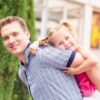 Happy father and daughter playing in the park — Stock Photo