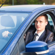 Handsome young businessman in his new car — Stock Photo #27522039