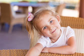Cute little child at the table in a restaurant — Stock Photo