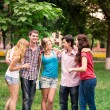 Stock Photo: Group of happy smiling Teenage Students