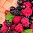 Fresh berries on a wicker backgound — Stock Photo