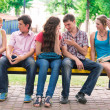 Group of happy smiling Teenage Students Outside — Stock Photo