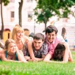 Stock Photo: Group of happy smiling Teenage Students Outside